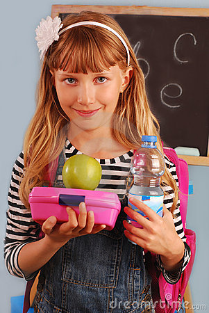 Schoolgirl with lunch box