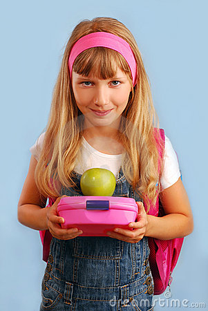 Schoolgirl with lunch box and apple