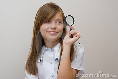 Schoolgirl with a magnifier