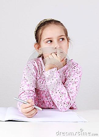Schoolgirl making homework