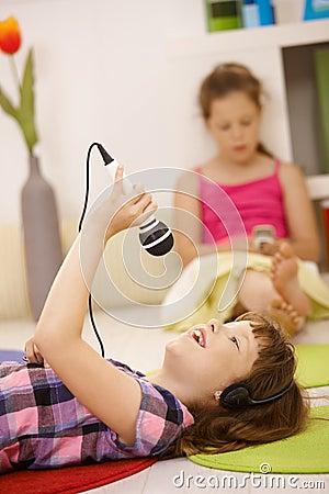 Schoolgirl with microphone and headphones