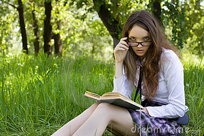 Schoolgirl in park read book