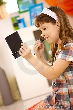 Schoolgirl playing with makeup