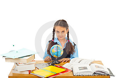 Schoolgirl at pupil with world globe