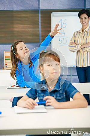 Schoolgirl with raised hand