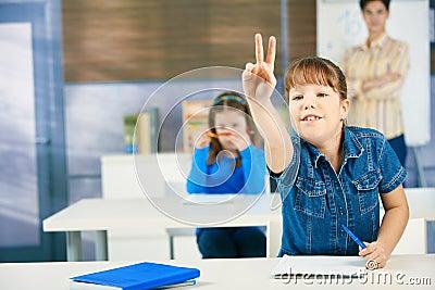 Schoolgirl raising hand