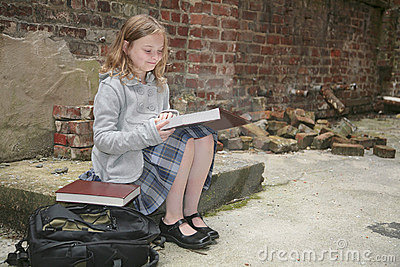 Schoolgirl reading outside