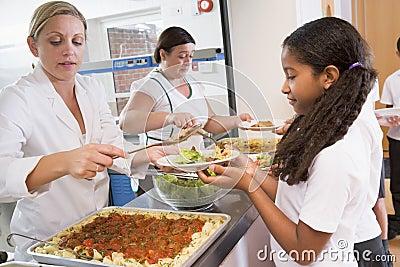 Schoolgirl in a school cafeteria
