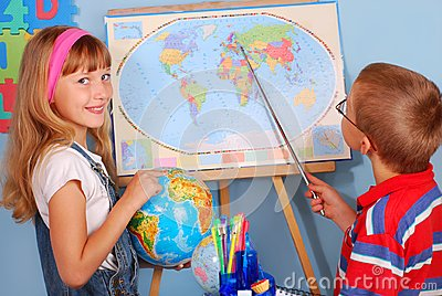 Schoolgirl  and schoolboy on geography lesson