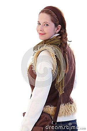 Schoolgirl with shoulder bag looking back