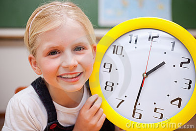 Schoolgirl showing a clock