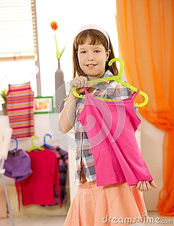 Schoolgirl showing nice top on hanger