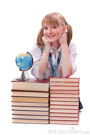 Schoolgirl with the stack of book and globe