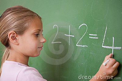 Schoolgirl writing a number