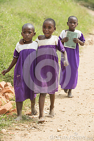 Schoolgirls in Africa barfoot with school uniform