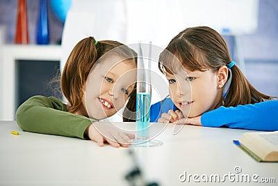 Schoolgirls in chemistry class