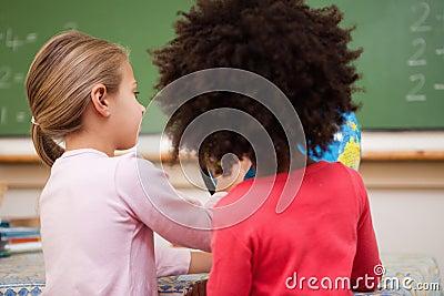 Schoolgirls looking at a globe