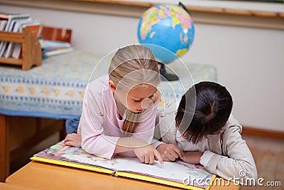 Schoolgirls reading a fairy tale