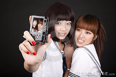 Schoolgirls taking self-portrait