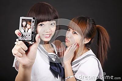 Schoolgirls taking self-portrait