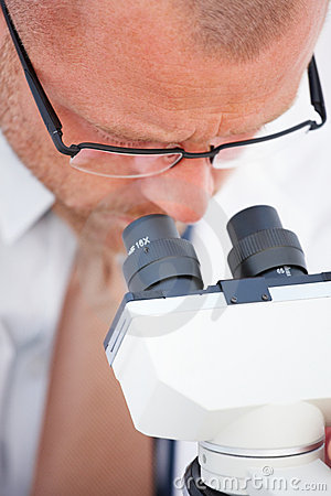 Science - Closeup of researcher using microscope