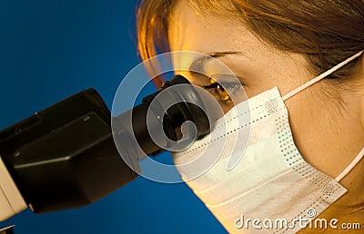 Scientific looking in microscope