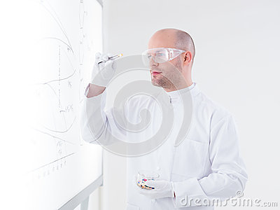 Scientist analyzing a pill