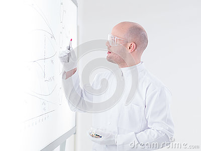 Scientist analyzing pink pill