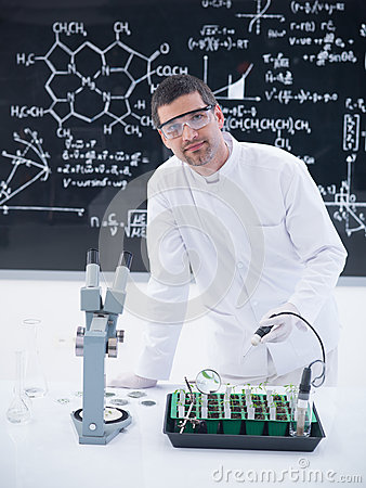 Scientist analyzing plants in lab