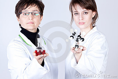 Scientist and assistant in lab
