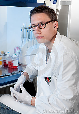 Scientist by cell culture hood