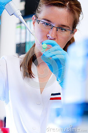 Scientist concentrates on her experiment