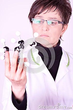 Scientist examing atoms