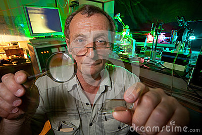 Scientist with glass, loupe pose in his lab
