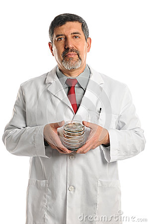 Scientist Holding Petri Dishes With Bacteria