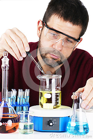 Scientist mixing chemicals