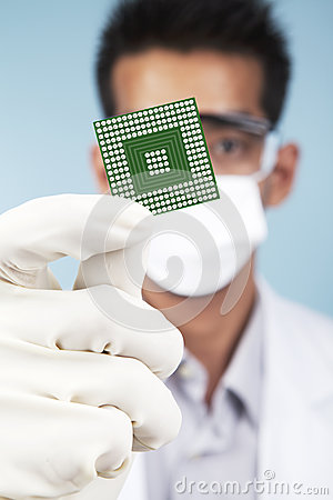 Scientist showing a microchip computer