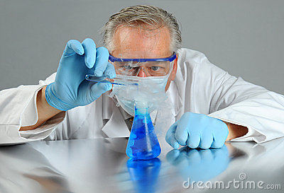 Scientist with test tube and beaker