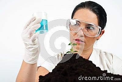 Scientist woman analyze blue liquid