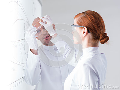 Scientists analyzing pill samples