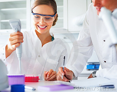 Scientists analyzing together in a laboratory