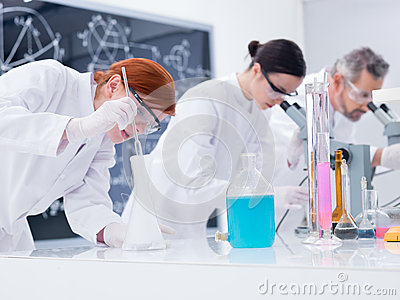 Scientists conducting lab experiments
