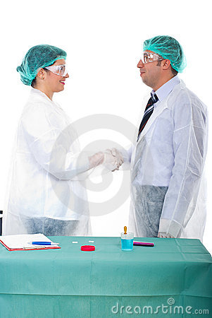 Scientists give handshake in a laboratory