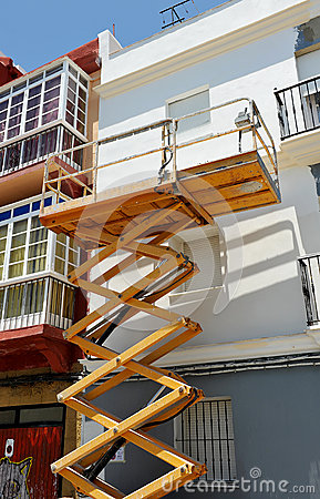 Scissor Lift Platform For Repair Of The Facade Of A House Stock Photo Image 62033188