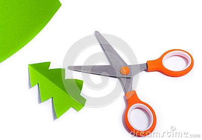 Scissors cut out fir of paper