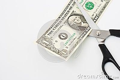 Scissors cuts one american dollar note