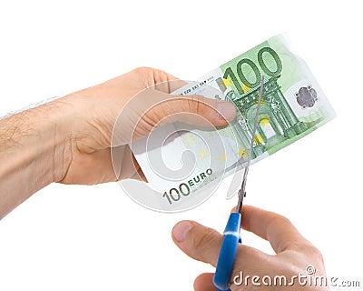 Scissors and euro.