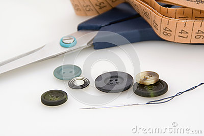 Scissors, measuring tape and buttons