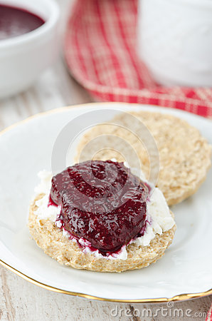 Free Scone With Goat Cheese And Jam On A Plate Closeup Vertical Stock Photos - 28818453