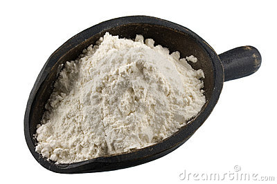 Scoop of wheat flour or other white powder